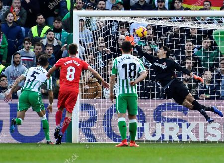 Girona's goalkeeper Yassine Bounou (R) concedes a goal during the Spanish La Liga soccer match between Real Betis and Girona FC at Benito Villamarin Stadium, in Seville, southern Spain, 20 January 2019.