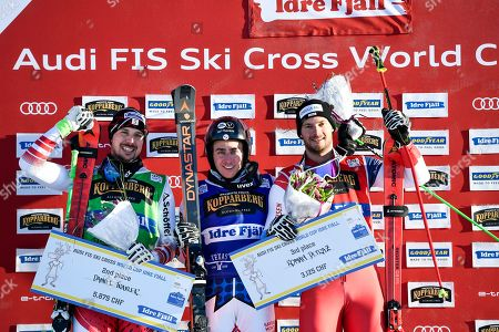 Winner Jean Frederic Chapuis (C) of France Daniel Traxler (L) Austria second place and Domain Detraz, (R) of Switzerland, celebrate on the podium after the Men's final FIS Freestyle Ski Cross World Cup event in Idre Fjall, Sweden, 20 January 2019.