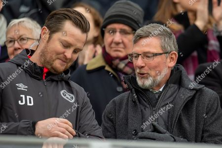 Craig Levein, manager of Heart of Midlothian speaks with coach Jon Daly (left) in the stand before the 4th round of the William Hill Scottish Cup match between Heart of Midlothian and Livingston at Tynecastle Stadium, Edinburgh