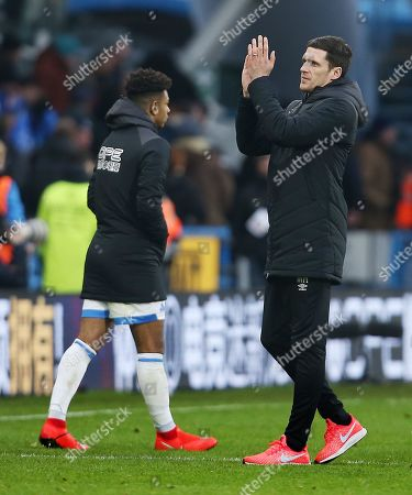 Huddersfield Town caretaker manager Mark Hudson thanks the fans at the end of the game