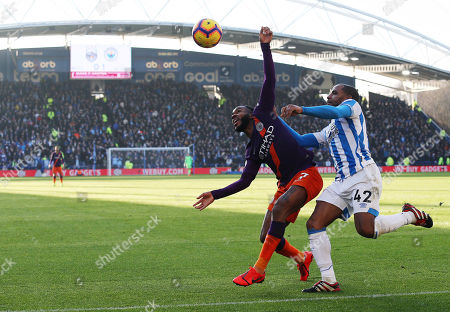 Raheem Sterling of Manchester City and Jason Puncheon of Huddersfield Town