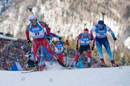 Krasimir Anev of Bulgaria (L), Simon Eder of Austria (2nd from right) and Benjamin Weger of Switzerland (R) perform in the men 15 km mass start race at the IBU Biathlon World Cup in Ruhpolding, Germany, 20 January 2019.