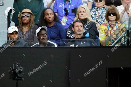 Oracene Price (L), Venus Williams (2-L), fashion editor Anna Wintour (R), and French tennis coach Patrick Mouratoglou (front, R) watch the women's singles fourth round match between Simona Halep of Romania and Serena Williams of the USA at the Australian Open Grand Slam tennis tournament in Melbourne, Australia, 21 January 2019.