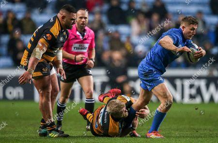 Wasps vs Leinster. Leinster?s Jordan Larmour with Ben Morris of Wasps