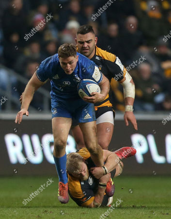 Leinster Rugby's Jordan Larmour is tackled by Wasps Ben Morris