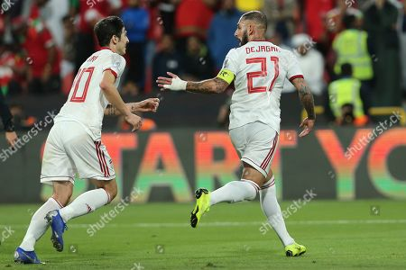 Iran's midfielder Ashkan Dejagah, right, celebrates with his teammate Sardar Azmoun after scoring his side's second goal during the AFC Asian Cup round of 16 soccer match between Iran and Oman at Mohammed Bin Zayed Stadium in Abu Dhabi, United Arab Emirates