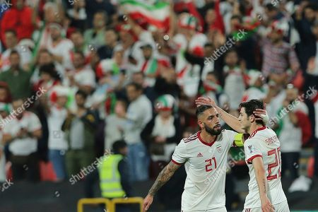 Iran's midfielder Ashkan Dejagah, left, celebrates with his teammate Sardar Azmoun after scoring his side's second goal during the AFC Asian Cup round of 16 soccer match between Iran and Oman at Mohammed Bin Zayed Stadium in Abu Dhabi, United Arab Emirates