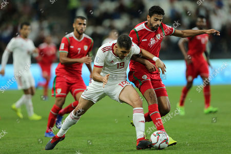 Stock Picture of Iran's defender Majid Hosseini, center, fights for the ball with Oman's forward Muhsen Al Ghassani during the AFC Asian Cup round of 16 soccer match between Iran and Oman at Mohammed Bin Zayed Stadium in Abu Dhabi, United Arab Emirates