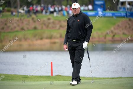 Former professional baseball player Roger Clemens waits to putt on the 18th green during the final round of the Tournament of Champions LPGA golf tournament, in Lake Buena Vista, Fla
