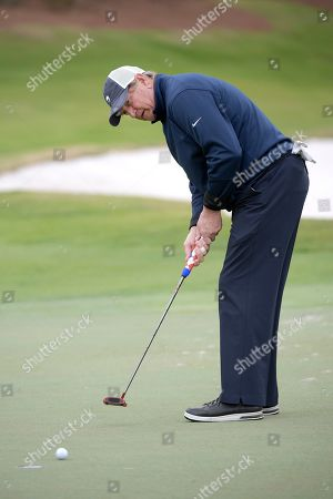Former NFL quarterback Joe Theismann watches his putt on the 18th green during the final round of the Tournament of Champions LPGA golf tournament, in Lake Buena Vista, Fla