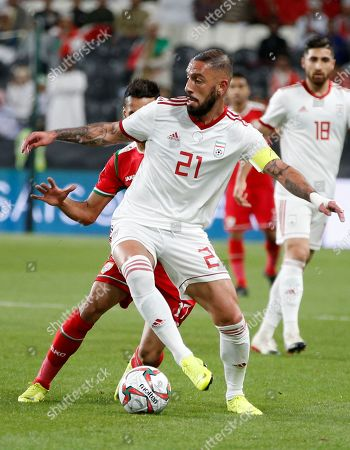 Ashkan Dejagah (Front) of Iran in action during the 2019 AFC Asian Cup round of 16 soccer match between Iran and Oman in Abu Dhabi, United Arab Emirates, 20 January 2019.