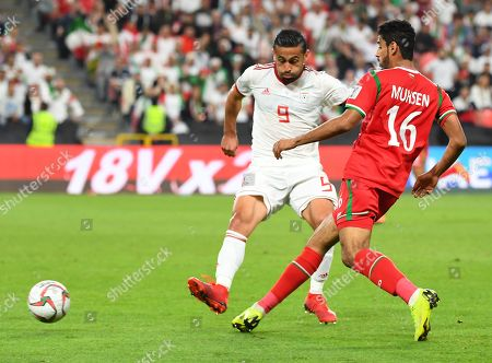 Omid Ebrahimi Zarandini (L) of Iran in action against Muhsen Al Ghassani of Oman during the 2019 AFC Asian Cup round of 16 soccer match between Iran and Oman in Abu Dhabi, United Arab Emirates, 20 January 2019.