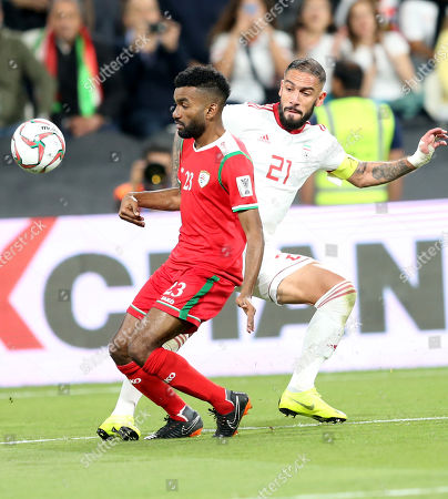 Seyed Ashkan Dejagah (R) of Iran in action during the 2019 AFC Asian Cup round of 16 soccer match between Iran and Oman in Abu Dhabi, United Arab Emirates, 20 January 2019.