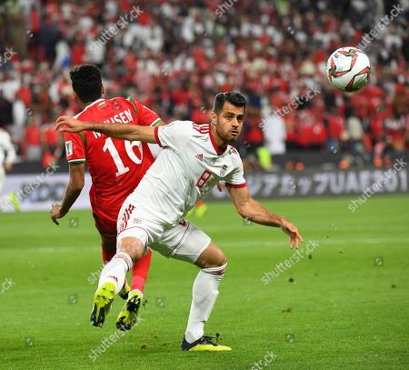 Morteza Pouraliganji (R) of Iran in action against Muhsen Al Ghassani of Oman during the 2019 AFC Asian Cup round of 16 soccer match between Iran and Oman in Abu Dhabi, United Arab Emirates, 20 January 2019.