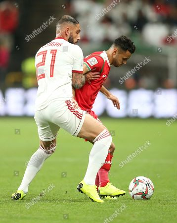 Ashkan Dejagah (L) of Iran in action during the 2019 AFC Asian Cup round of 16 soccer match between Iran and Oman in Abu Dhabi, United Arab Emirates, 20 January 2019.
