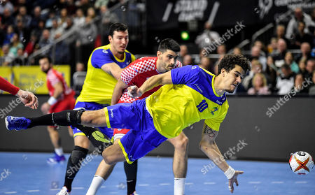Brazil's Jose Toledo jumps for the ball to score during the Handball World Championship Main Round Group 1 match between Brazil and Croatia in Cologne, Germany