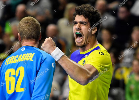 Brazil's Jose Toledo, right, celebrates after winning the Handball World Championship Main Round Group 1 match between Brazil and Croatia in Cologne, Germany