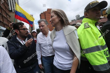 Colombian former President Juan Manuel Santos (C) and Former Colombian First Lady Maria Clemencia Rodriguez (2-R) attend a march against terrorism in Bogota, Colombia, 20 January 2019. Thousands of Colombians took the streets nationwide to protest against terrorism after a car bombing attack at a police academy in Bogota that left at least 21 dead - including the attacker - and 68 injured.