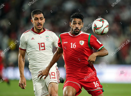 Muhsen Al-Ghassani of Oman and Majid Hosseini of Iran challening for the ball during Iran v Oman at the Zayed Sports City Stadium in Abu Dhabi, United Arab Emirates, AFC Asian Cup, Asian Football championship