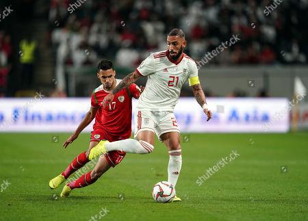 Ashkan Dejagah of Iran in front of Ali Al-Busaidi of Oman during Iran v Oman at the Zayed Sports City Stadium in Abu Dhabi, United Arab Emirates, AFC Asian Cup, Asian Football championship