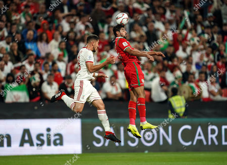 Muhsen Al-Ghassani of Oman and Majid Hosseini of Iran challenging for the ball during Iran v Oman at the Zayed Sports City Stadium in Abu Dhabi, United Arab Emirates, AFC Asian Cup, Asian Football championship