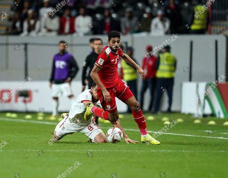 Muhsen Al-Ghassani of Oman going past Morteza Pouraliganji of Iran during Iran v Oman at the Zayed Sports City Stadium in Abu Dhabi, United Arab Emirates, AFC Asian Cup, Asian Football championship