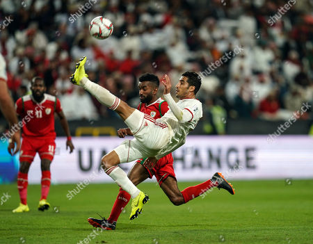 Morteza Pouraliganji of Iran clearing the ball during Iran v Oman at the Zayed Sports City Stadium in Abu Dhabi, United Arab Emirates, AFC Asian Cup, Asian Football championship