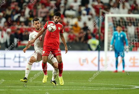 Muhsen Al-Ghassani of Oman taking the ball down in front of Morteza Pouraliganji of Iran during Iran v Oman at the Zayed Sports City Stadium in Abu Dhabi, United Arab Emirates, AFC Asian Cup, Asian Football championship