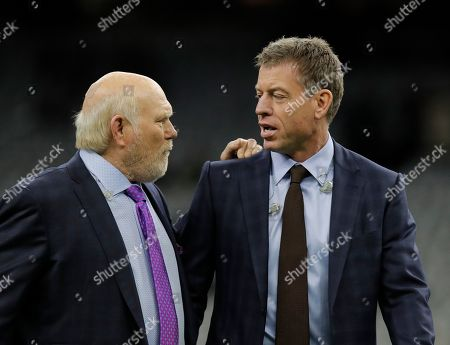 Former NFL quarterback Terry Bradshaw, left speaks with broadcaster and former NFL quarterback Troy Aikman before the NFL football NFC championship game between the New Orleans Saints and the Los Angeles Rams, in New Orleans