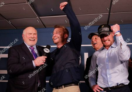 Los Angeles Rams head coach Sean McVay reacts in the locker room with broadcaster Terry Bradshaw after overtime of the NFL football NFC championship game against the New Orleans Saints, in New Orleans. The Rams won 26-23