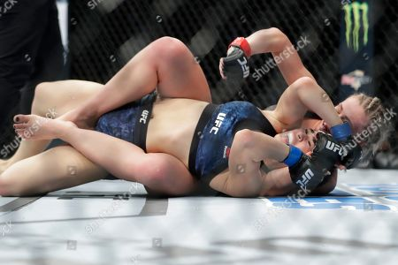Paige Vanzant, right, wrestles with Rachael Ostovich during the second round of a women's flyweight mixed martial arts bout at UFC Fight Night, in New York. Vanzant stopped Ostovich in the second round