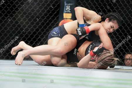 Stock Picture of Rachael Ostovich, above, punches Paige VanZant during the first round of a women's flyweight mixed martial arts bout at UFC Fight Night, in New York. Vanzant stopped Ostovich in the second round