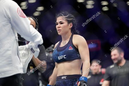Rachael Ostovich reacts after losing a women's flyweight mixed martial arts bout against Paige Vanzant at UFC Fight Night, in New York. Vanzant stopped Ostovich in the second round