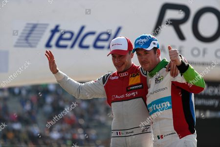 Stock Photo of Winner Benito Guerra, of Mexico, right, poses for a photo with runner-up Loic Duval, of France, as they leave the track following the final Race of Champions at Foro Sol in Mexico City, . The Race of Champions was held for the first time in Latin America