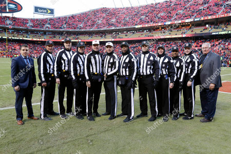Stock Image of Replay assistant Tyler Cerimeli, head linesman Kent Payne (79), line judge Dana McKenzie (8), umpire Bryan Neale (92), referee Clete Blakeman (34), referee Tony Corrente (99), field judge Terry Brown (43), field judge Brad Freeman (88), back judge Greg Meyer (78), field judge Adrian Hill (29), head linesman Derick Bowers (74) and Replay official Carl Madsen pose for a photo before the AFC Championship NFL football game between the Kansas City Chiefs and the New England Patriots, in Kansas City, Mo