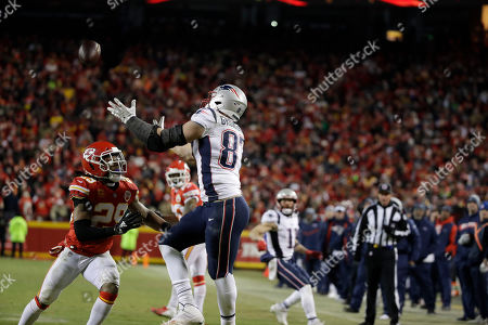 Stock Image of New England Patriots tight end Rob Gronkowski (87) makes a catch against Kansas City Chiefs defensive back Eric Berry (29) during the second half of the AFC Championship NFL football game, in Kansas City, Mo