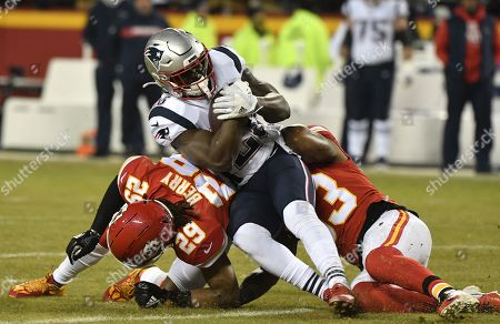 New England Patriots running back Sony Michel (C) gets tackled by Kansas City Chiefs defensive back Eric Berry (L) during the first half of the AFC Championship NFL American football game between the New England Patriots and the Kansas City Chiefs at Arrowhead Stadium in Kansas City, Missouri, USA, 20 January 2019.