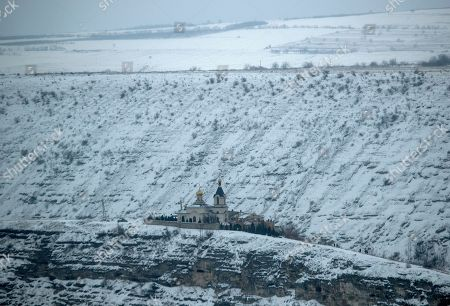 A general view over St. Maria church (L) with and the Bell Tower of the cave monastery (R) in the historical and archaeological complex Orheiul Vechi (Old Orhei), in Butuceni village, Moldova, 20 January 2019. Located some 60 kilometres outside Chisinau, the natural and historical complex Orheiul Vechi is a popular tourist site.