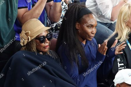 Venus Williams (R) and her mother Oracene Price (L) watch the women's singles fourth round match between Simona Halep of Romania and Serena Williams of the USA at the Australian Open Grand Slam tennis tournament in Melbourne, Australia, 21 January 2019.