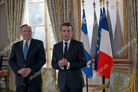 French President Emmanuel Macron speaks to the media as he greets Quebec Premier Francois Legault (L) prior to their meeting at the Elysee Palace in Paris, France, 21 January 2019.