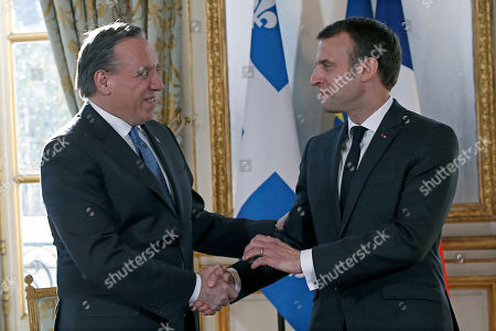 French President Emmanuel Macron greets Quebec Premier Francois Legault (L) prior to their meeting at the Elysee Palace in Paris, France, 21 January 2019.