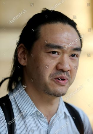 Victim Jeph Ko is seen outside the District Court in Adelaide, South Australia, 21 January 2019. Jeph Ko was dragged more than 60 meters trapped underneath a van after his laptop was stolen by two men at suburban Norwood in 2016. Kieran Callaghan-Wight, 27, was on Monday jailed for four years, six months over the attack, while co-accused James Watts, 31, was handed a sentence of four years, four months.