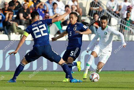 Saudi Arabia's midfielder Hattan Bahebri, right, takes the ball past Japan's defender Maya Yoshida during the AFC Asian Cup round of 16 soccer match between Japan and Saudi Arabia at the Sharjah Stadium in Sharjah, United Arab Emirates