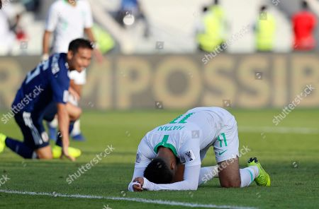 Saudi Arabia's midfielder Hattan Bahebri reacts after missing a chance during the AFC Asian Cup round of 16 soccer match between Japan and Saudi Arabia at the Sharjah Stadium in Sharjah, United Arab Emirates
