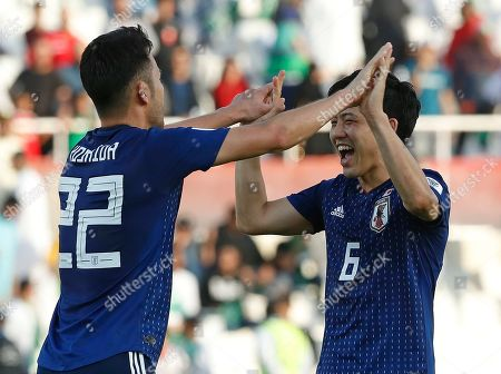 Japan's defender Maya Yoshida, left, and Japan's defender Wataru Endo celebrate after the AFC Asian Cup round of 16 soccer match between Japan and Saudi Arabia at the Sharjah Stadium in Sharjah, United Arab Emirates, . Japan won the match 1-0
