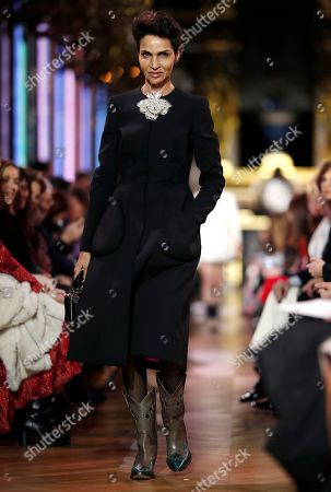 Stock Picture of French-Algerian actress, director and model Farida Khelfa presents a creation from the Spring/Summer 2019 Haute Couture collection by French designer Bertrand Guyon for Schiaparelli during the Paris Fashion Week, in Paris, France, 21 January 2019. The presentation of the Haute Couture collections runs from 21 to 24 January.