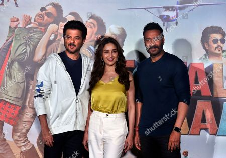 Anil Kapoor, Madhuri Dixit, Ajay Devgan. Bollywood actors Anil Kapoor, left, Madhuri Dixit, center, and Ajay Devgan pose for photographers at the trailer launch of their upcoming movie 'Total Dhamaal' in Mumbai, India, . The movie is scheduled to be released on Feb. 22, 2019