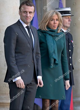 French President Emmanuel Macron and his wife Brigitte are seen at the Elysee Palace in Paris, France, 21 January 2019, during Premier of Quebec Francois Legault's visit.