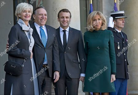 French President Emmanuel Macron (2-R) and his wife Brigitte (R) greet Prime Minister of Quebec Francois Legault (2-L) and his wife Isabelle Brais (L) as they arrive for a meeting at the Elysee Palace in Paris, France, 21 January 2019.