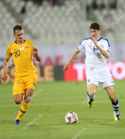 Eldor Shomurodov (R) of Uzbekistan in action against Trent Sainsbury of Australia during the 2019 AFC Asian Cup round of 16 soccer match between Australia and Uzbekistan in Al Ain, United Arab Emirates, 21 January 2019.